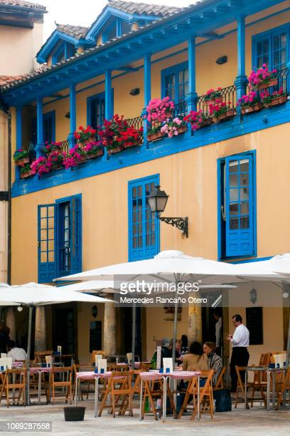 Sidewalk cafe terrace, multicolored facade, Oviedo, Asturias, Spain.