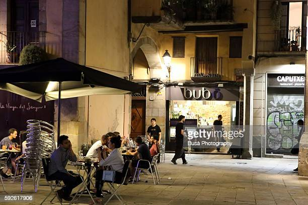 Sidewalk cafes at night in the El Born district of Barcelona, Catalonia, Spain