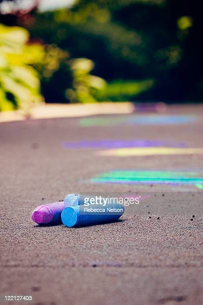 sidewalk chalk abandoned on sidewalk - rebecca nelson stock pictures, royalty-free photos & images