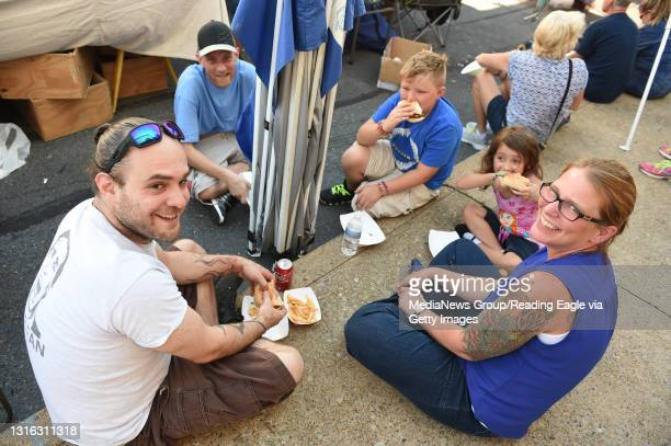 Sidewalk dining among friends was shared by, from left, Brett LePore of Muhlenberg Township, Shawn Rock of Cumru Township, Jeremiah Daniels of...