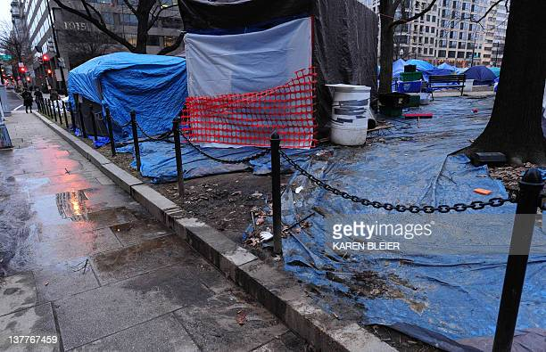 A sidewalk flowing with liquid is seen in the Occupy DC encampment in McPherson Square in Washington DC January 26 2012 AFP PHOTO/Karen BLEIER