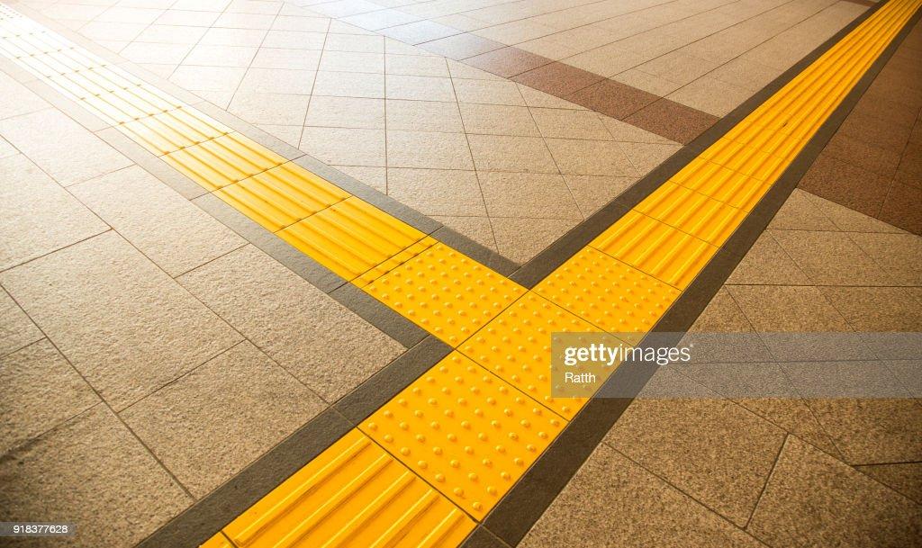 Sidewalk guides for blind : Stock Photo