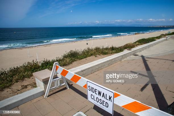 A sidewalk is pictured closed in Redondo Beach California on March 28 2020 Los Angeles County closed all beaches today as a new measure to stem the...