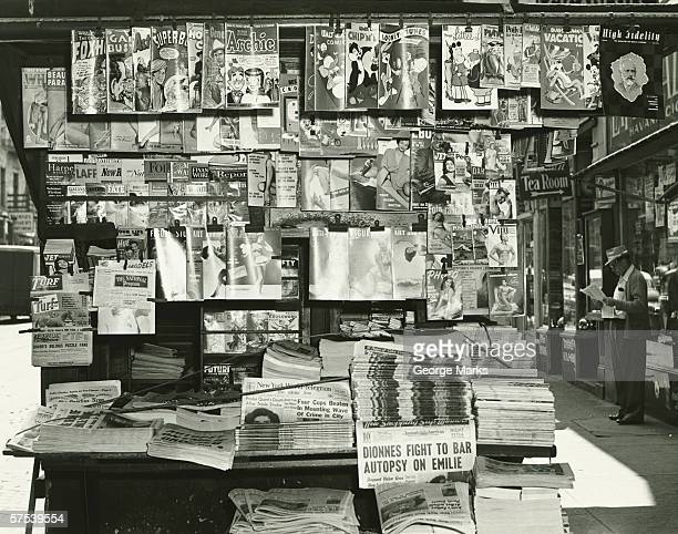 sidewalk newspaper and magazine stand, (b&w) - news stand stock pictures, royalty-free photos & images