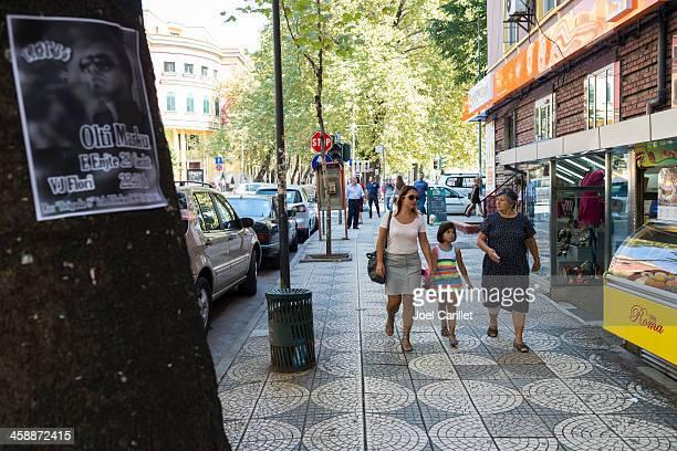 sidewalk scene in tirana, albania - tirana stock pictures, royalty-free photos & images