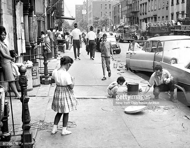 Sidewalk scene on 4th St. Between Avenue A an B in the East Village.