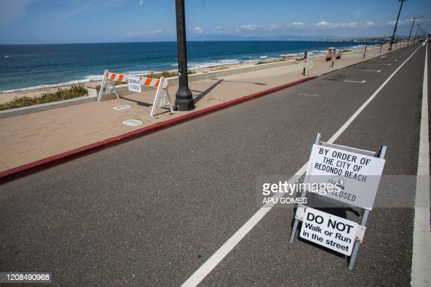 Sidewalks and bike path are pictured closed in Redondo Beach California on March 28 2020 Los Angeles County closed all beaches today as a new measure...