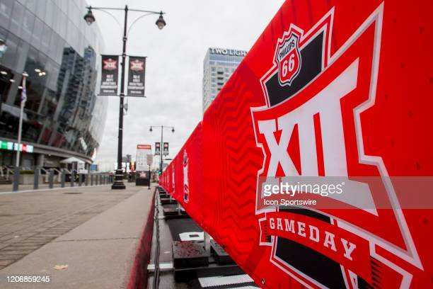Sidewalks next to the Big 12 fan experience activations stand empty due to the cancellation of the Big 12 Tournament to prevent the spread of the...
