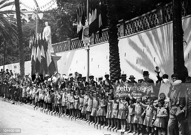 SidiFerruch young Algerian girls hold small flags and greet President Gaston DOUMERGUE who inaugurates the monuments during the festivities...