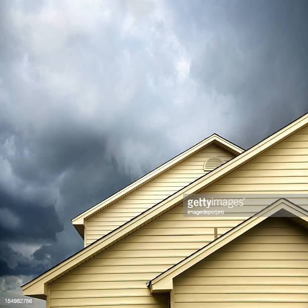 siding house under storm