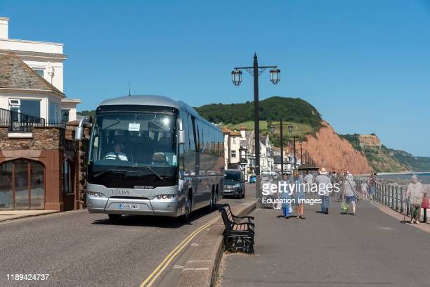 Sidmouth Devon England Motor coach on the seafront at Sidmouth a popular holiday resort in East Devon