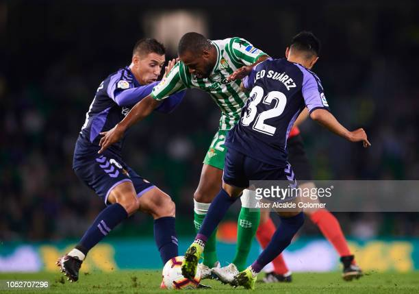 Sidnei Rechel Da Silva of Real Betis competes for the ball with Leonardo Suarez of Real Valladolid CF during the La Liga match between Real Betis...