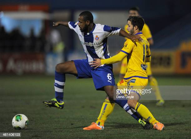 Sidnei Rechel of Espanyol shields the ball from Antonio Martinez of AD Alcorcon during the Copa del Rey Round of 16, 1st leg match between Alcorcon...