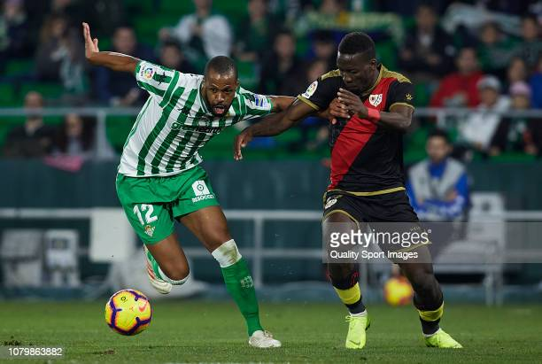 Sidnei Rechel of Real Betis competes for the ball with Advincula of Rayo Vallecano during the La Liga match between Real Betis Balompie and Rayo...
