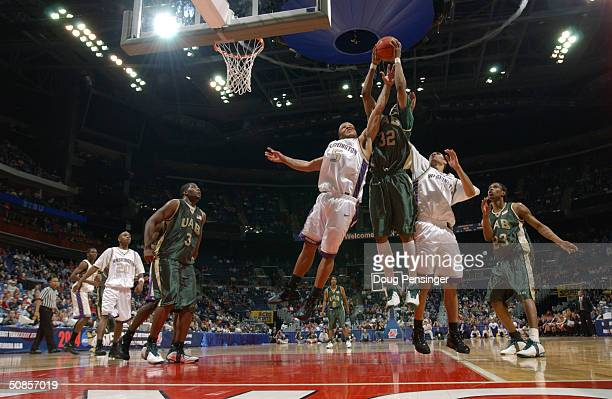 Sidney Ball of the Alabama Birmingham Blazers grabs a rebound between Will Conroy and Tre Simmons of the Washington Huskies in the first round game...