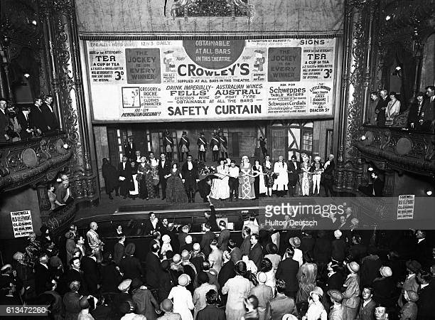Sidney Barnard and his company at the Elephant Theatre sing 'Auld Lang Syne' at the end of their performance which is the last one before the theatre...