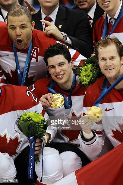 Sidney Crosby of Canada and teammates celebrate with their gold medals after winning the ice hockey men's gold medal game between USA and Canada on...