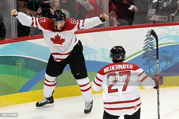 Sidney Crosby of Canada celebrates with teammate Scott Niedermayer after scoring the matchwinning goal in overtime during the ice hockey men's gold...