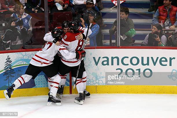 Sidney Crosby of Canada celebrates with teammates after scoring the matchwinning goal in overtime during the ice hockey men's gold medal game between...