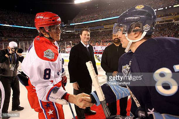 Sidney Crosby of the Pittsburgh Penguins shakes hands with Alex Ovechkin of the Washington Capitals prior to the 2011 NHL Bridgestone Winter Classic...