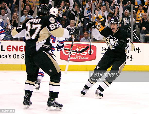 Sidney Crosby and Evgeni Malkin of the Pittsburgh Penguins celebrate a second period goal by Marian Hossa against the New York Rangers during game...