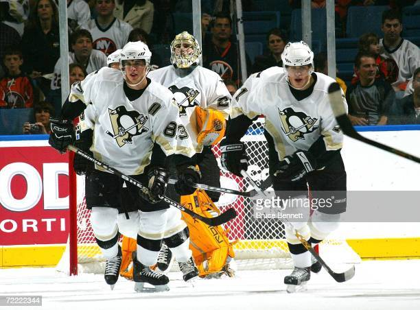 Sidney Crosby and Evgeni Malkin of the Pittsburgh Penguins skate against the New York Islanders on October 19 2006 at the Nassau Coliseum in...