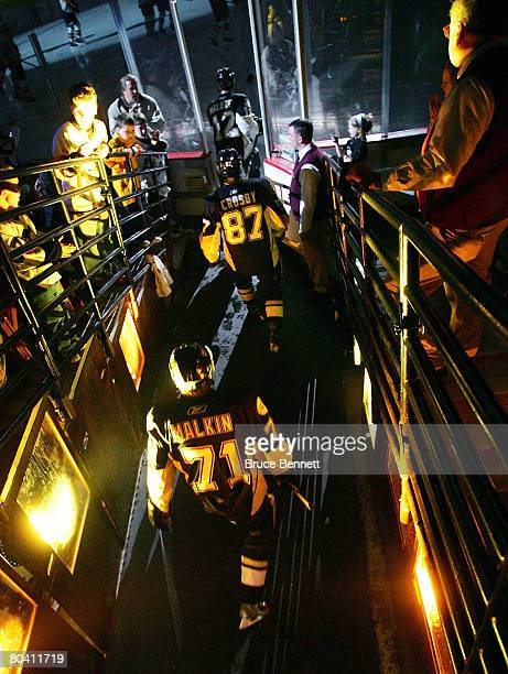 Sidney Crosby and Evgeni Malkin of the Pittsburgh Penguins walk to the ice for their game against the New York Islanders on March 27 2008 at the...