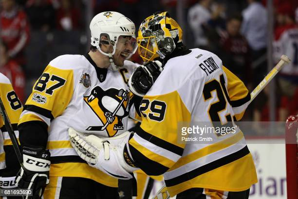 Sidney Crosby and goalie MarcAndre Fleury of the Pittsburgh Penguins celebrate following the Penguins 20 win over the Washington Capitals in Game...