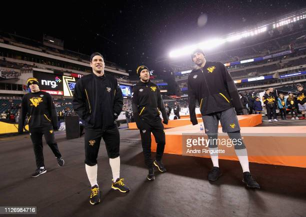 Sidney Crosby and his Pittsburgh Penguins teammates look on during warmup prior to the 2019 Coors Light NHL Stadium Series game between the...