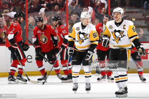 Sidney Crosby and Jake Guentzel of the Pittsburgh Penguins react after the fourth goal scored by Ottawa Senators during the first period in Game...