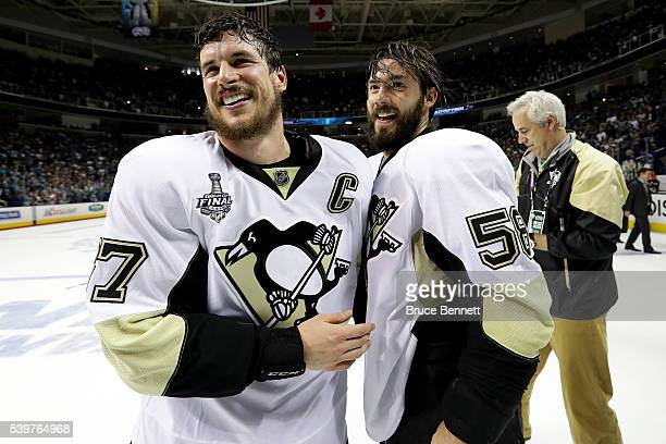 Sidney Crosby and Kris Letang of the Pittsburgh Penguins celebrate after their 31 victory to win the Stanley Cup against the San Jose Sharks in Game...
