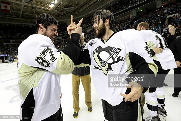 Sidney Crosby and Kris Letang of the Pittsburgh Penguins celebrate after their 3-1 victory to win the Stanley Cup against the San Jose Sharks in Game...