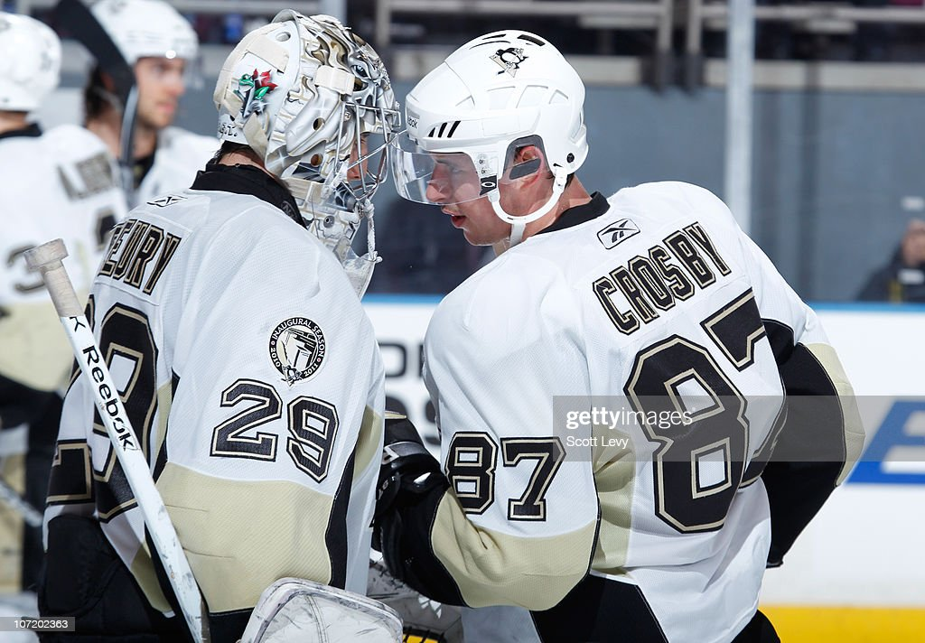 Sidney Crosby #87 and Marc-Andre Fleury #29 of the Pittsburgh Penguins celebrate the win against the New York Rangers on November 29, 2010 at Madison Square Garden in New York City. The Penguins defeat the Rangers 3-1.