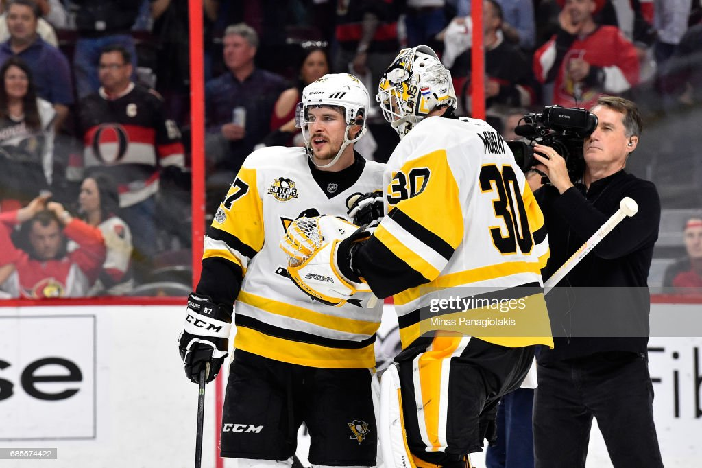 Sidney Crosby #87 and Matt Murray #30 of the Pittsburgh Penguins talk after defeating the Ottawa Senators with a score of 3 to 2 in Game Four of the Eastern Conference Final during the 2017 NHL Stanley Cup Playoffs at Canadian Tire Centre on May 19, 2017 in Ottawa, Canada.