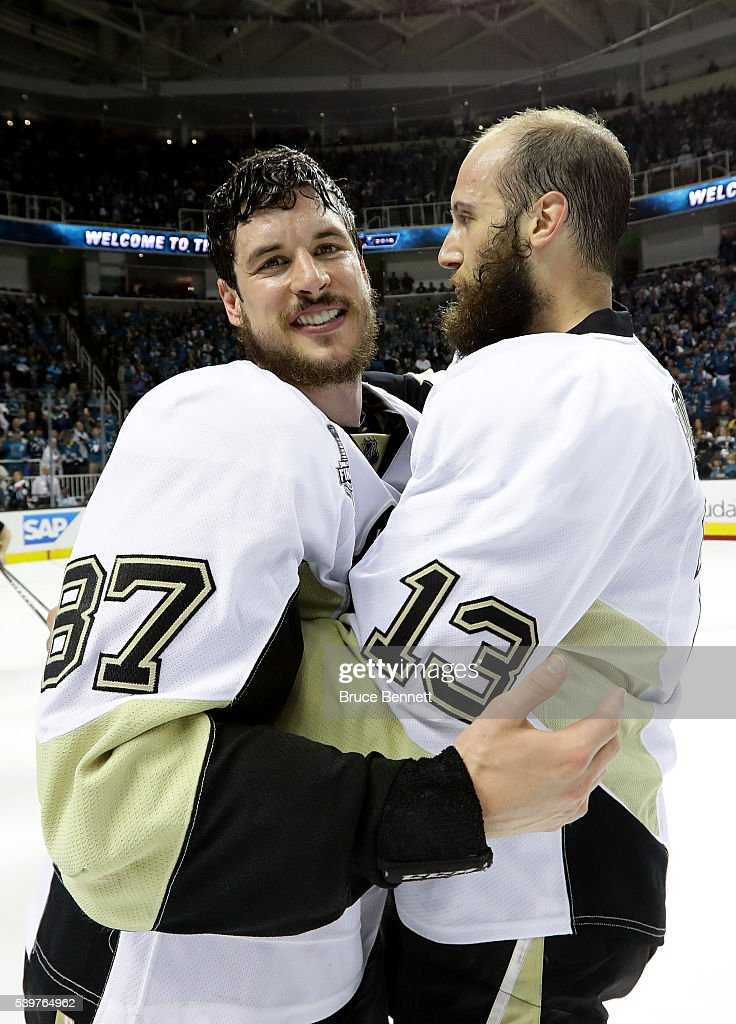 Sidney Crosby #87 and Nick Bonino #13 of the Pittsburgh Penguins celebrate after their 3-1 victory to win the Stanley Cup against the San Jose Sharks in Game Six of the 2016 NHL Stanley Cup Final at SAP Center on June 12, 2016 in San Jose, California.