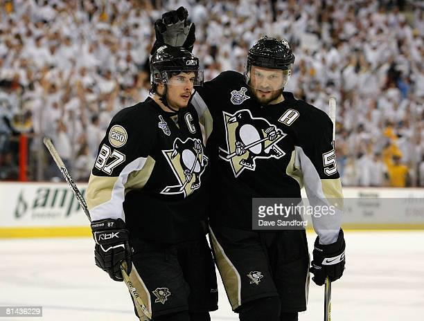 Sidney Crosby and Sergei Gonchar of the Pittsburgh Penguins celebrate after Evgeni Malkin scored a second period power play goal against the Detroit...