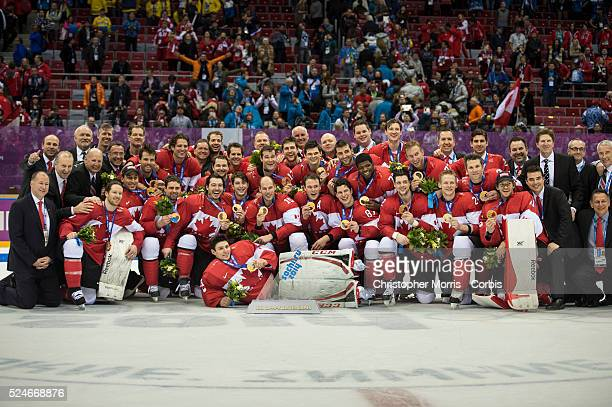 Sidney Crosby and Team Canada celebrate their gold medal win after the Sochi 2014 Winter Olympic Games Men's hockey Gold medal game against Sweden...