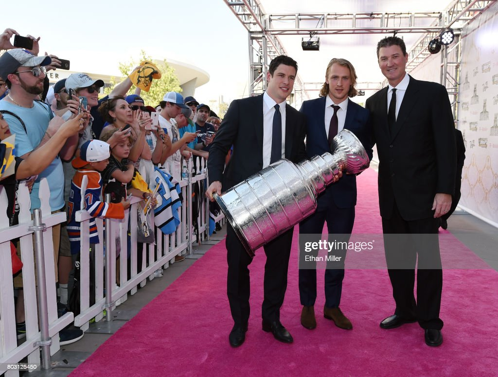 Sidney Crosby, Carl Hagelin and owner Mario Lemieux of the Pittsburgh Penguins carry the Stanley Cup as they arrive at the 2017 NHL Awards at T-Mobile Arena on June 21, 2017 in Las Vegas, Nevada.