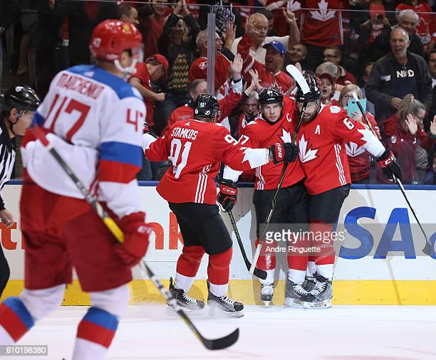 Sidney Crosby celebrates with Steven Stamkos and Shea Weber of Team Canada after scoring a first period goal on Team Russiaat the semifinal game...