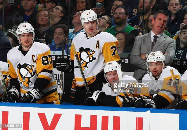 Sidney Crosby Evgeni Malkin and head coach Mike Sullivan of the Pittsburgh Penguins follow the play from the bench during an NHL game against the...
