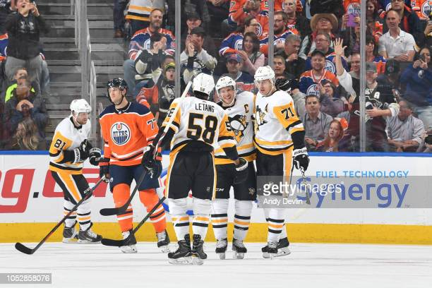 Sidney Crosby Evgeni Malkin and Kris Letang of the Pittsburgh Penguins celebrate after a goal during the game against the Edmonton Oilers on October...