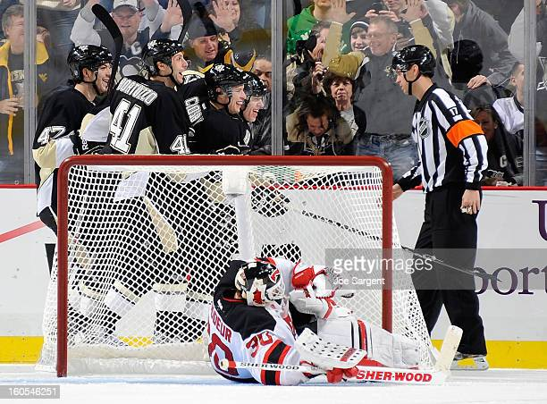 Sidney Crosby Evgeni Malkin and Robert Bortuzzo of the Pittsburgh Penguins celebrate a goal by Brandon Sutter in front of Martin Brodeur of the New...