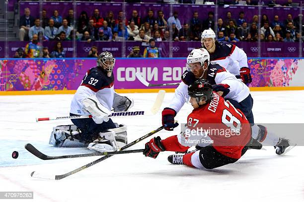 Sidney Crosby of Canada attempts to score against Brooks Orpik and Jonathan Quick of the United States during the Men's Ice Hockey Semifinal Playoff...
