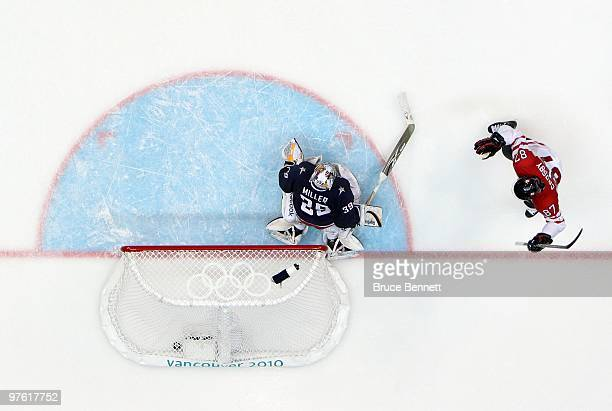 Sidney Crosby of Canada celebrates his gamewinning goal in overtime against Ryan Miller of USA in the ice hockey men's gold medal game between USA...
