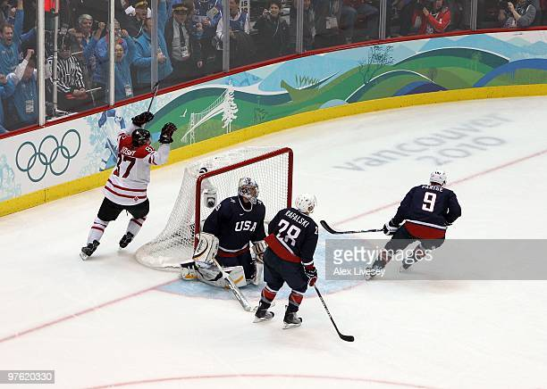 Sidney Crosby of Canada celebrates his gamewinning goal in overtime against Ryan Miller of USA during the ice hockey men's gold medal game between...