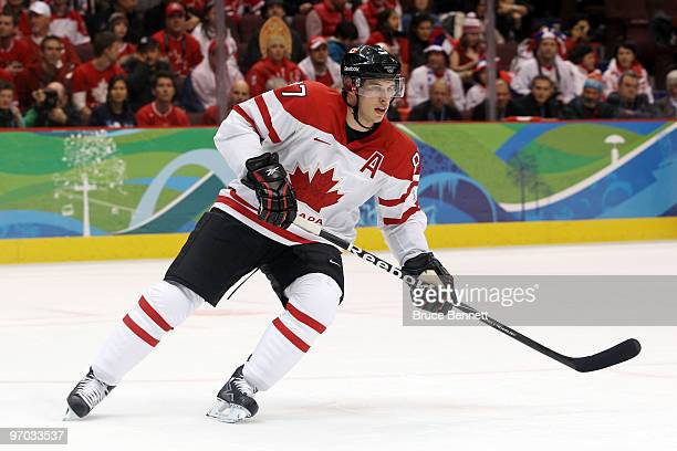 Sidney Crosby of Canada controls the puck during the ice hockey men's quarter final game between Russia and Canada on day 13 of the Vancouver 2010...