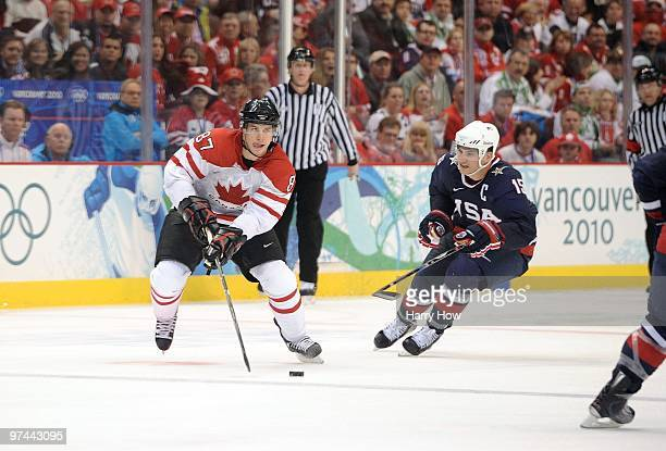 Sidney Crosby of Canada plays the puck through the neutral zone on the offensive rush past Jamie Langenbrunner of USA several seconds before scoring...