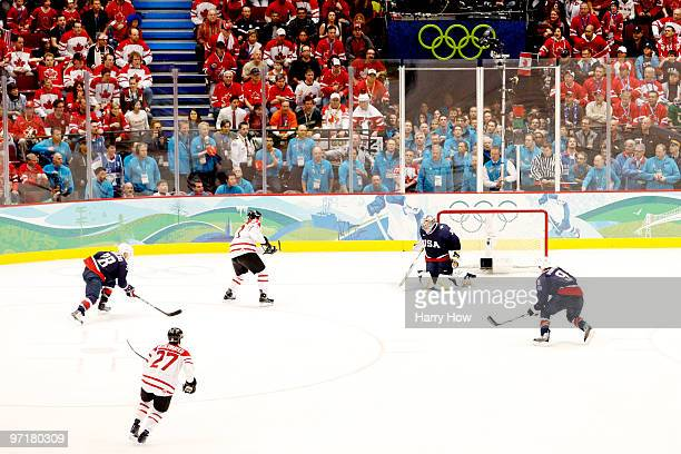 Sidney Crosby of Canada scores the game winning goal against Ryan Miller of the United States in overtime of the ice hockey men's gold medal game...