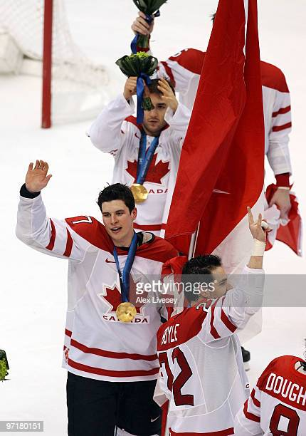 Sidney Crosby of Canada waves to the fans after receiving the gold medal following his team's 32 overtime victory during the ice hockey men's gold...