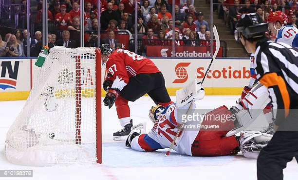 Sidney Crosby of Team Canada gets the puck past Sergei Bobrovsky of Team Russia to score a first period goal at the semifinal game during the World...